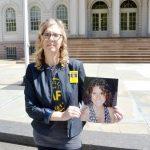 Judy Kottick displays a photo of her daughter Ella.