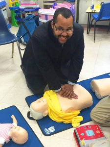Assemblymember Pichardo practices his CPR. Photo: Facebook