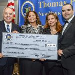 DiNapoli presents unclaimed funds to the Puerto Rican Bar Association.