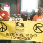 Los defensores iban de naranja, un color que se utiliza para aumentar la conciencia sobre la seguridad de las armas.