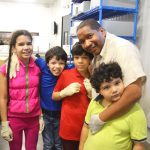 """""""It's important to help others in the community,"""" said Site Manager Emilio Good, with his children."""