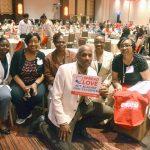 """I applaud you,"" said State Senator Bill Perkins (center), here with nurses from Harlem Hospital."