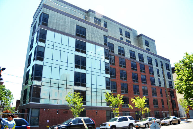 The project provides 107 apartments and on-site support services.