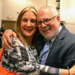 BCM Executive Director Carla Precht embraces Boardmember Richard Stein.