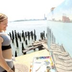 Speaker Melissa Mark-Viverito takes in a painting of the shoreline.