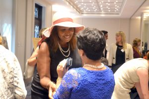 Public Advocate Letitia James greets a fellow attendee.