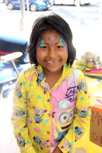 Heidi, 8, shows off her butterfly face painting.