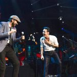Juan Luis Guerra (left) recently joined Anthony in concert.