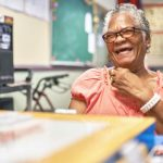 Doris, a client at the Betances Senior Center, shares a laugh.