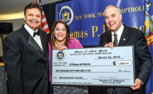 Comptroller DiNapoli presents El Museo del Barrio with a check.