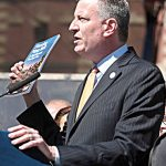 The focus is on Mayor Bill de Blasio's plans for private development on NYCHA land.