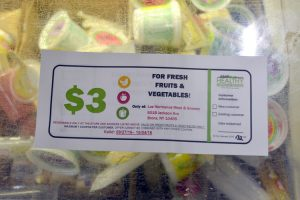 Community members received coupons to purchase discounted produce.