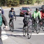 A few of the more than 7,000 riders pass Mosholu Parkway.