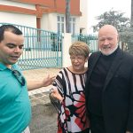 From left to right: Assemblymember Marcos Crespo, Head Start Director Carmen Villafañe, and Msgr. Kevin Sullivan.