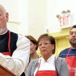 """""""Our belief is that both charity and helping people is not limited to merely one neighborhood, one area,"""" says Sullivan (at podium)."""