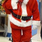 Raymond hosted the party as Santa.