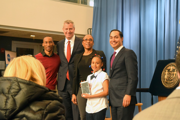 The Suarez family, here with Mayor Bill de Blasio and HUD Secretary Julián Castro, were the first to receive a tablet.