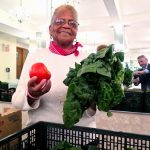 Ann Jenkins of Hunger Free America's Food Action Board helps distribute food.