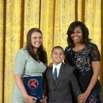 Ian poses with the First Lady and Asborno (left). Photo: Steven E. Purcell