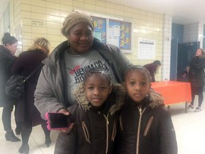 Ms. Kone attended the meeting with her two children.