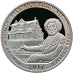 A coin with Frederick Douglass's likeness.