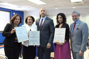 From left to right: Alcántara; García Reyes; Díaz Jr.; Luz Tavarez; and Dr. David Gómez, President of Hostos Community College.