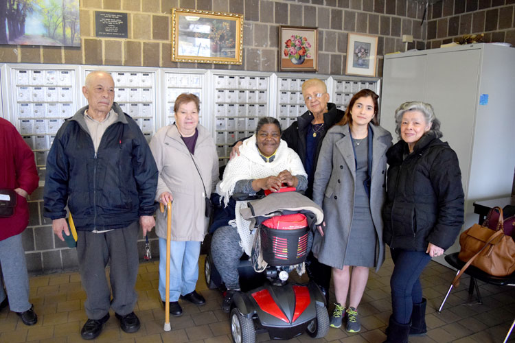 Building residents with community advocate Marjorie Velázquez (far right, in gray coat).