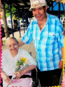 Olegario Pabón (standing, in blue shirt) was killed by an elevator malfunction in December 2015.
