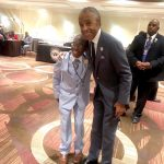 Sharpton with a young attendee.