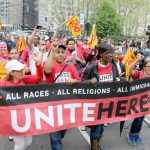 Members of UNITE HERE! Local 100 marched together.