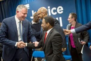 Mitchell in a meeting with Mayor Bill de Blasio earlier this year.