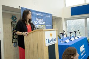 Malalis at the podium.