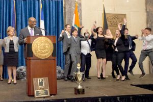 The moment of decision. New York Civil Court Judge Eddie McShan (at podium) with 8th grade winners, PS/IS 71 in the Bronx. Photo: Nick Carter Photography Inc.