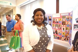 Dominique Auguste is the Site Administrator at the Comprehensive Health Care Center.
