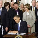 President Barack Obama signs ACA in March 2010.