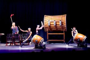 Hear the sound of taiko drums.