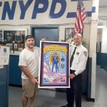 Artist Hernandez De Cesare (left) presents tribute artwork to Inspector Philip Rivera, Commanding Officer of the 46th Precinct.