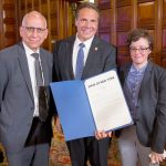 Gov. Andrew Cuomo (center) holds the signed bill; to his left is the city's Director of Intergovernmental Affairs Emma Wolfe and to his right is the city's Budget Director Dean Fuleihan. Photo: Philip Kamrass/ Office of Governor Andrew M. Cuomo