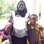 """It was a big help to me,"" said Adama Sambou, here with her children, of the program."