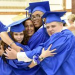 The proud graduates of the Schermerhorn and Van Cleve programs celebrate with a group hug. Photo: James Rivera
