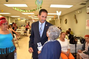 Councilmember Fernando Cabrera speaks with residents.