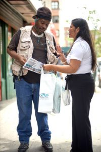 A MetroPlus team member speaks with a resident.