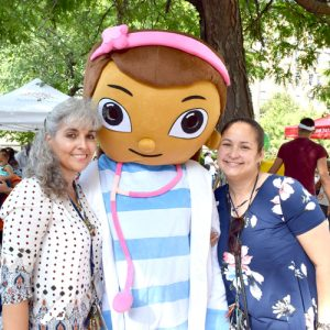 """We try to make it fun,"" said Acacia Vice President of Skilled Nursing Adriene Rosell, with Adrianne Angel on the right, pose with ""Doc."""