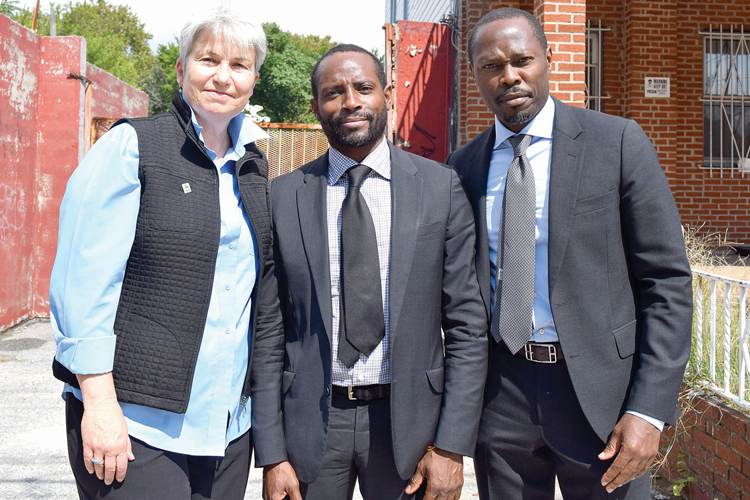 """Home ownership provides stability to the entire community,"" said Habitat for Humanity CEO Karen Haycox with Almat principals Donald Matheson (center) and Uche Alozie."