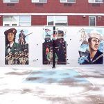 The basketball court boasts military murals.