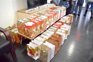 Volunteers prepared gift bags for residents.