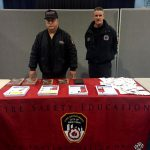 FDNY officers providing fire safety tips.