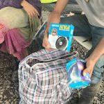 Farmers at agro ecological farm Finca Don Luis unpack the Eco Kit.