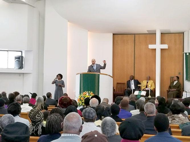 Borough President Rubén Díaz Jr. speaks at Trinity Baptist Church.