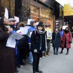 """Restaurant workers deserve the same wage,"" said organizer Kathy Amiliategui (center)."
